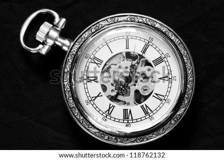 Old watch machine on black background