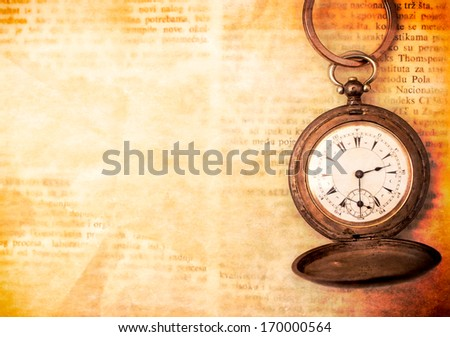Old watch on the paper with blank space for the text
