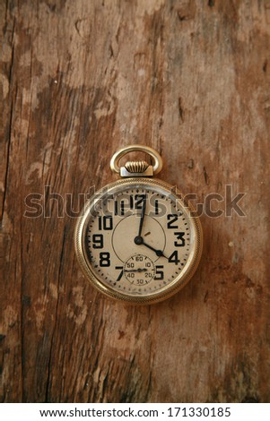 old watch on wood
