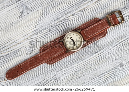 Old watches on white wooden background. Clipping path included