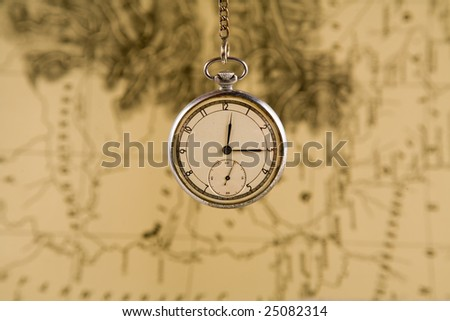 Old watches over blurry map background, sepia toned