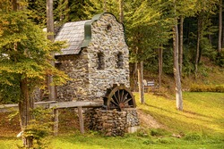 Old water mill. Old stone mill in the forest.