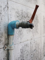 Old water tab have water drip out, concept shortage water in World for Water Day.