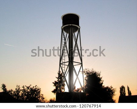 old water tank silhouette at sunset