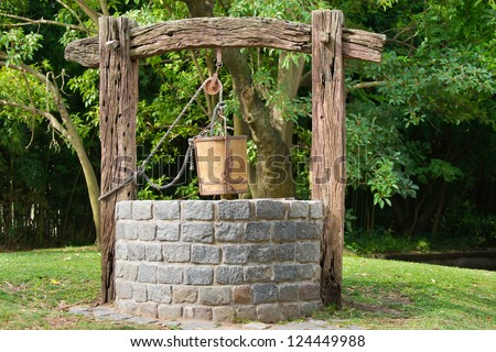 Old Water Well With Pulley and Bucket Stock photo ©