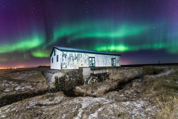 Old watermill in Iceland with northern lights.