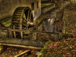 old watermill with waterwheel worked as hdr