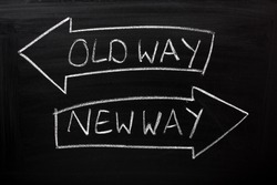 Old Way, New Way written on a blackboard with arrows pointing in the direction of the past and the future. A concept for adapting to change, improvement and development for the self or the business