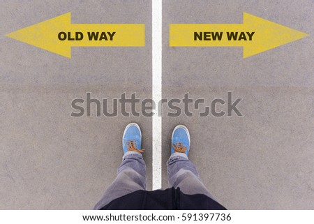 Old way or new way choice; text on asphalt ground, feet and shoes on floor, personal perspective footsie concept #591397736