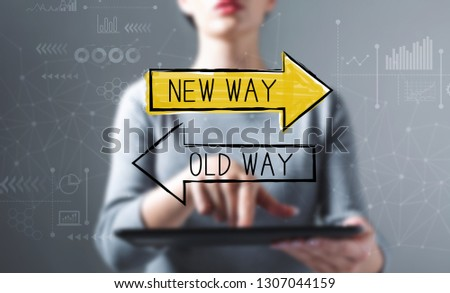 Old way or new way with business woman using a tablet computer #1307044159