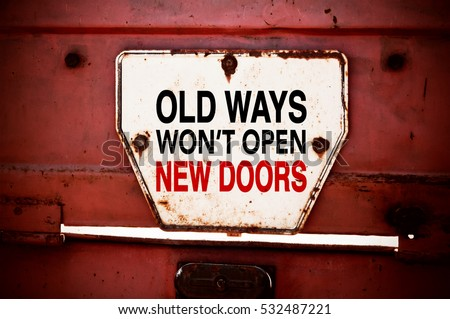 Old Ways Won't Open New Doors. Motivational quote. Innovation and creativity concept written on a grunge iron signboard