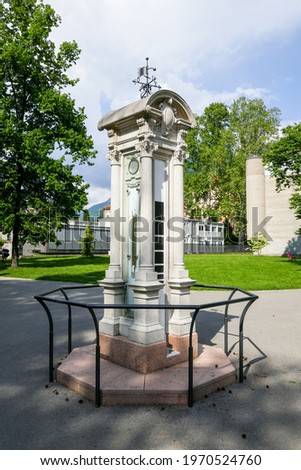 Old weather station in a classic white stone column including barometer, lumnimeter and weather vane. Location: the Ciani Park in Lugano (canton of Ticino, Switzerland). Zdjęcia stock ©