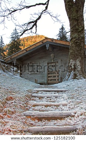old weathered alpine hut and stairway, rural scenery in november