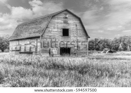 old weathered barn in black and white