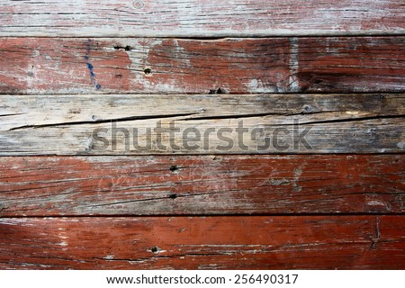 Old weathered barn wood texture with knots and nail holes.