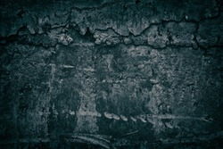 Old weathered concrete wall with hardened cement drips. Gloomy dark grunge background