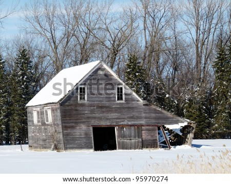old weathered farm building in winter