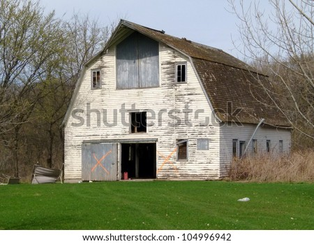 old weathered farm buildings white barn - stock photo