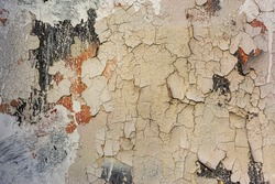 Old Weathered Painted Multicolored Plastered Peeled Wall Background. Cracked Flaked Shabby Wall With Rundown Stucco Layer Texture.