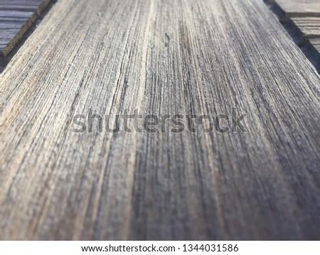 Old weathered teak wood table close-up #1344031586