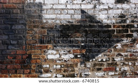 Old weathered urban wall with arrow
