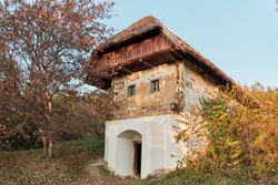 Old weathered wine cellar house in rural Hungary.