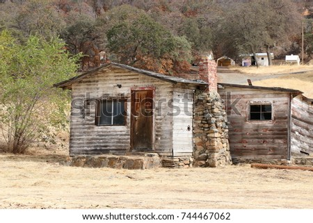 old weathered wooden cabin ...