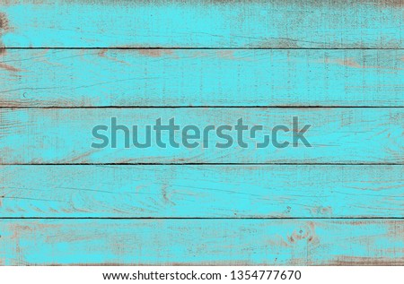 Old weathered wooden plank painted in turquoise blue color. Vintage beach wood background. #1354777670