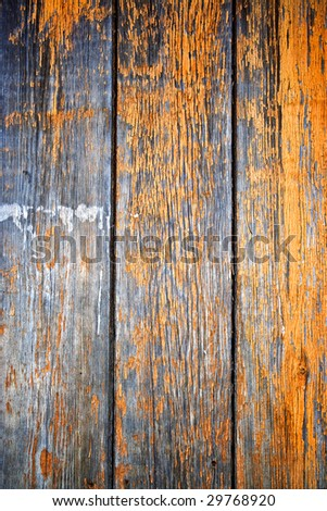 Old weathered wooden planks with peeling paint - stock photo