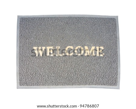 Old welcome doormat on the white background.