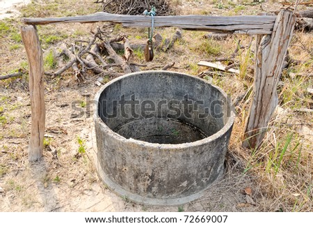 Old well on the paddy field ,countryside of Thailand.