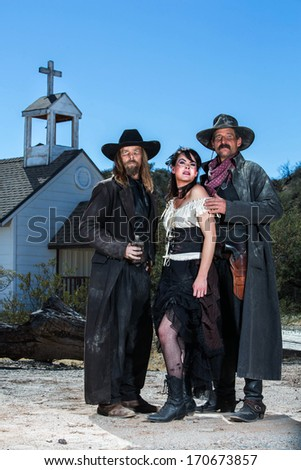 Old West Characters Pose Infront of Church
