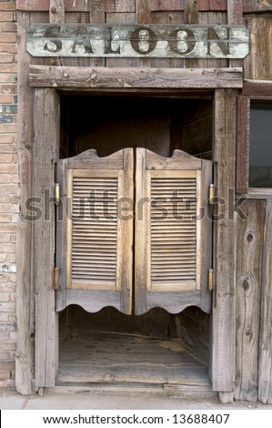 Old Western Swinging Saloon Doors with a Saloon Sign Above Doors