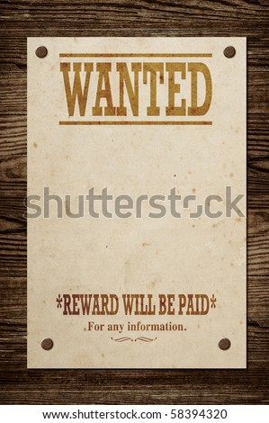 Old western wanted sign on wooden wall.