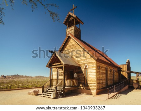 Old Western Wooden Church in Goldfield Gold Mine Ghost Town in Youngsberg, Arizona, USA surrounded by desert
