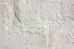 Old white brick wall background. White painted wall in sunny day