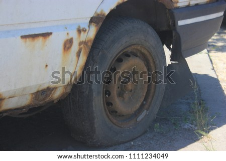 old white car with metal corrosion - protect your vehicle, commercial advertising idea  #1111234049