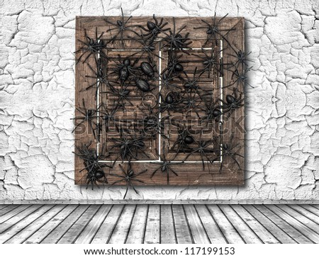 old white cracked wall and wooden window with black spider. halloween background