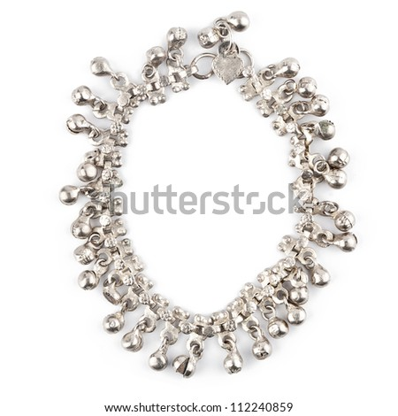 Old white metal bracelet isolated on white
