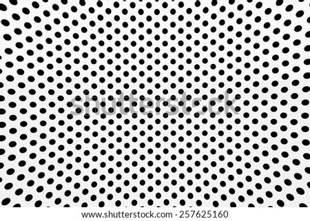 Old white metal grille with a black hole.