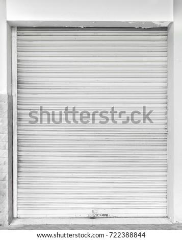 Old white metal roller shutter door.