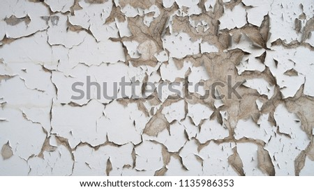 old white paint on a cement wall