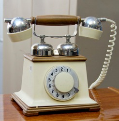old white phone with a rotary dialer. The phone's birthday is March 7.