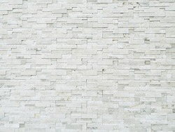 Old white stone brick wall vintage texture background,Wallpaper patter grid surface,Stone wall vintage texture background