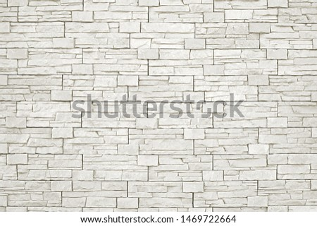 Old white stone mosaic wall background texture close up