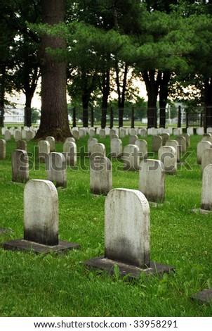 Old white tombstones in a canadian christian catholic cemetery. - stock photo