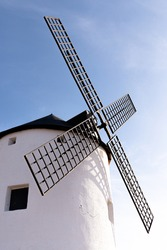 old white windmill from castile la mancha in spain europe don quixote blue sky