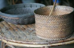old wickerwork baskets on the wickerwork table