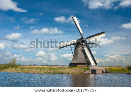 Old windmill in a Dutch countryside with blue sky