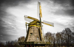 Old windmill in autumn day